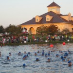 Swimmers take to the lake at the Katy Triathlon at Firethorne